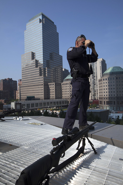 . Port Authority Police Department snipers provide security at the 9/11 Memorial during ceremonies for the 12th anniversary of the terrorist attacks on lower Manhattan at the World Trade Center site on September 11, 2013 in New York City.  (Photo by Allan Tannenbaum-Pool/Getty Images)