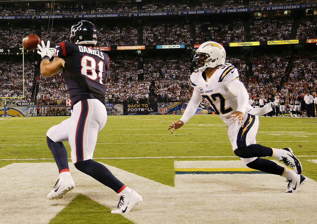 . Houston Texans tight end Owen Daniels, left, scores while being defended by San Diego Chargers defensive back Jahleel Addae during the first half of an NFL football game Monday, Sept. 9, 2013, in San Diego. (AP Photo/Gregory Bull)