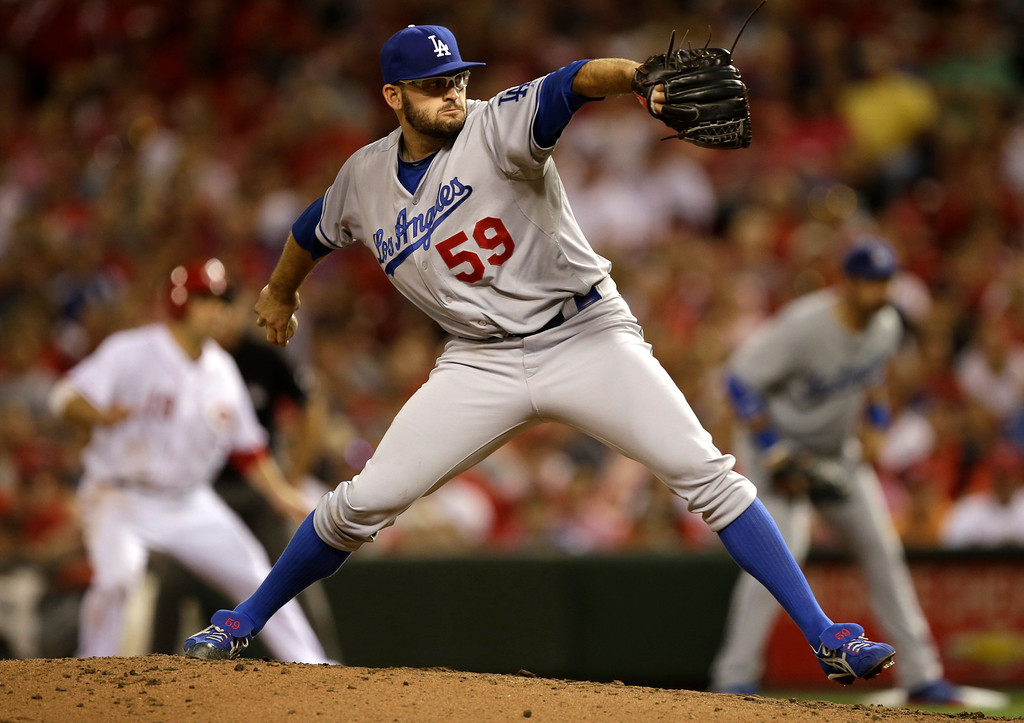 . Los Angeles Dodgers starting pitcher Stephen Fife pitches against the Cincinnati Reds in the fourth inning of a baseball game, Friday, Sept. 6, 2013, in Cincinnati. (AP Photo/Al Behrman)