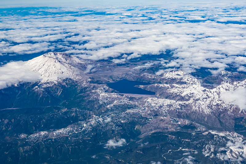 Aerial view of Mount Saint Helens and Spirit Lake in winter with snow covering peaks