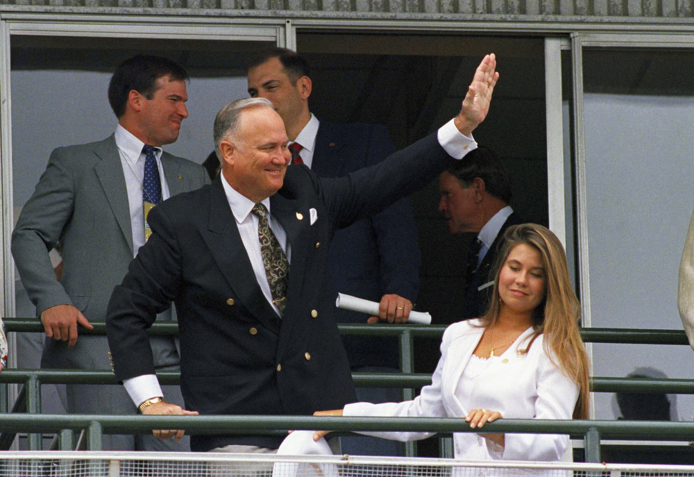 . Gen. Norman Schwarzkopf and his daughter, Cynthia, take in the sites from the balcony at Churchill Downs as they wait for the start of the 117th running of the Kentucky Derby, Saturday, May 4, 1991 in Louisville, Ky. (AP Photo/Mike Fisher)