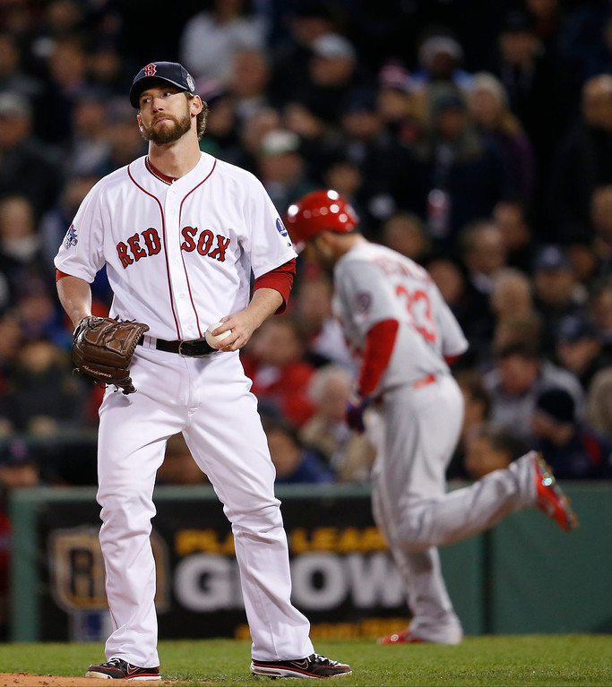 . Boston Red Sox relief patcher Craig Breslow reacts after walking St. Louis Cardinals\' Daniel Descalso, right, during the seventh inning of Game 2 of baseball\'s World Series Thursday, Oct. 24, 2013, in Boston. (AP Photo/Elise Amendola)