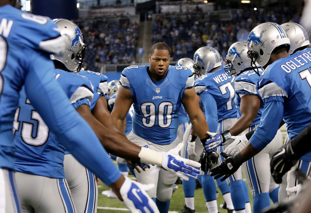 . Detroit Lions defensive tackle Ndamukong Suh (90) is introduced before a preseason NFL football game against the Jacksonville Jaguars at Ford Field in Detroit, Friday, Aug. 22, 2014.  (AP Photo/Duane Burleson)
