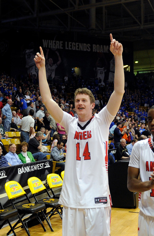 . BOULDER, CO. - MARCH 15: Angels senior Keaghan Dunn-Rhodes celebrated the win. The East High School boy\'s basketball team defeated Legend 58-45 Friday night, March 15, 2013 at the Coors Events Center in a 5A semifinal playoff game.  (Photo By Karl Gehring/The Denver Post)