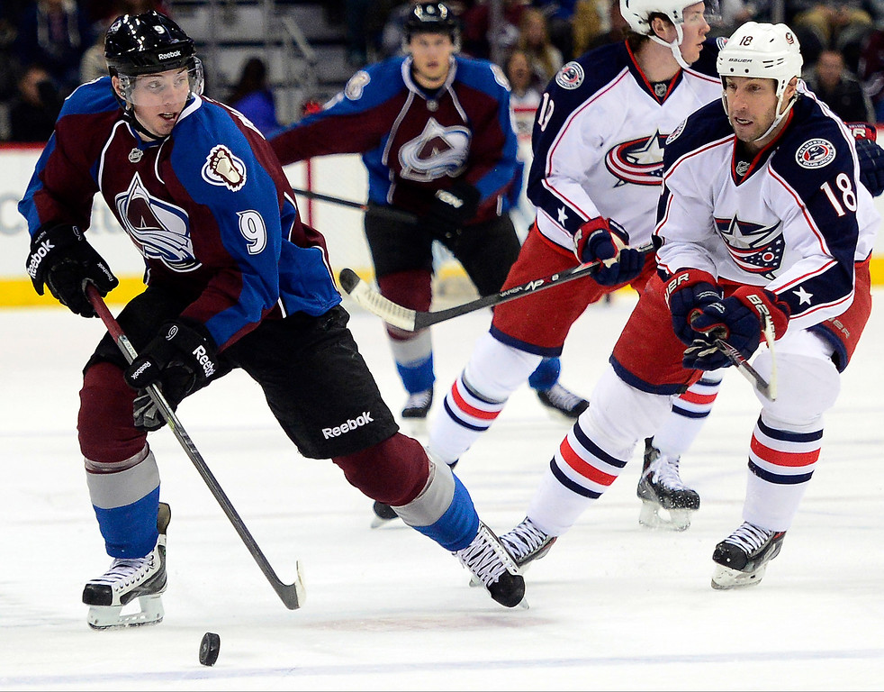 . Matt Duchene (9) of the Colorado Avalanche controls the puck as R.J. Umberger (18) of the Columbus Blue Jackets pursues during the first period. The Colorado Avalanche hosted the Columbus Blue Jackets at the Pepsi Center on Tuesday, December 31, 2013. (Photo by AAron Ontiveroz/The Denver Post)