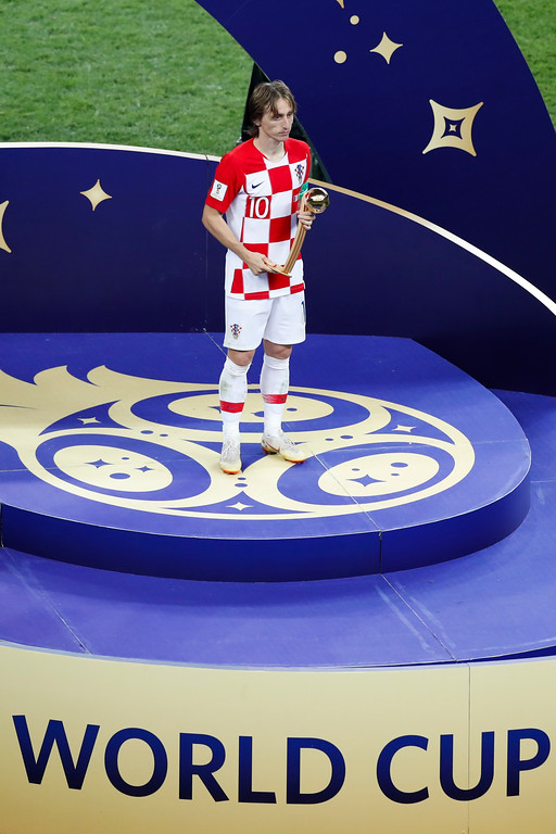 . Croatia\'s Luka Modric holds the golden ball as best player of the tournament after his team lost the the final match between France and Croatia at the 2018 soccer World Cup in the Luzhniki Stadium in Moscow, Russia, Sunday, July 15, 2018. (AP Photo/Rebecca Blackwell)