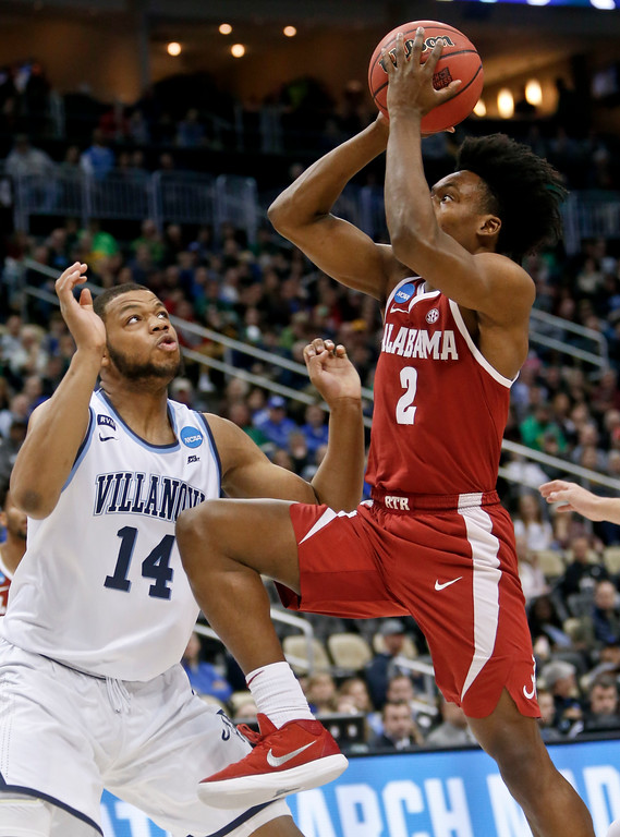 . Alabama\'s Collin Sexton (2) shoots over Villanova\'s Omari Spellman (14) during the first half of a second-round game in the NCAA men\'s college basketball tournament, Saturday, March 17, 2018, in Pittsburgh. (AP Photo/Keith Srakocic)