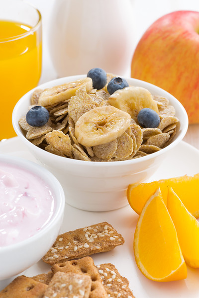 healthy breakfast - cereals, dairy products, fruit and juice, vertical, close-up