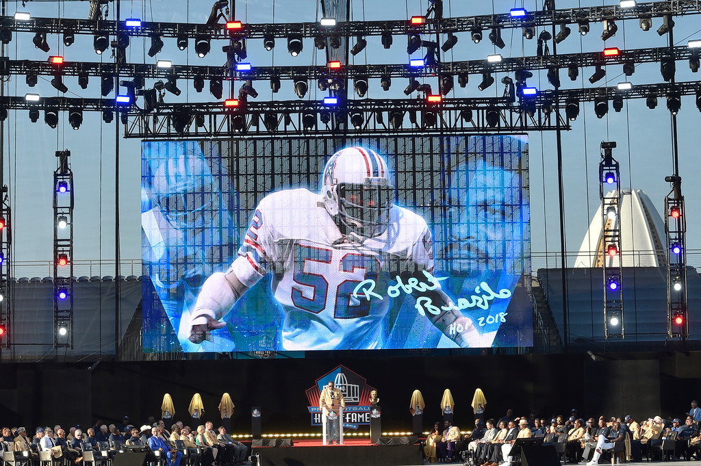 . Former NFL player Robert Brazile delivers his induction speech at the Pro Football Hall of Fame on Saturday, Aug. 4, 2018, in Canton, Ohio. (AP Photo/David Richard)