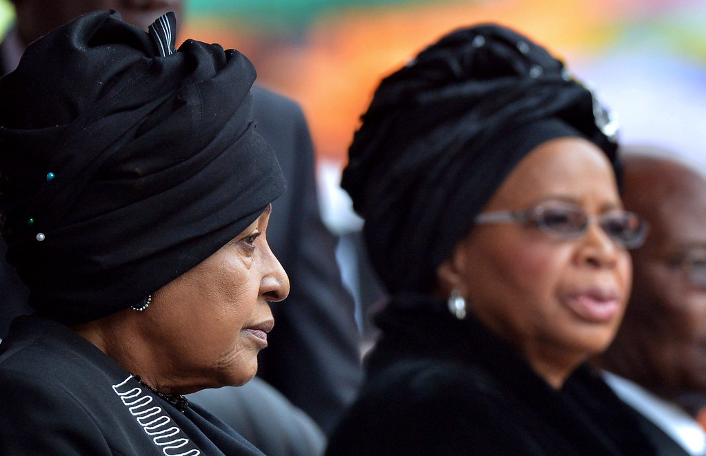 . Winnie Madikizela Mandela (L) and widow Graca Machel attend the memorial service for late South African President Nelson Mandela at Soccer City Stadium in Johannesburg on December 10, 2013. Mandela, the revered icon of the anti-apartheid struggle in South Africa and one of the towering political figures of the 20th century, died in Johannesburg on December 5 at age 95. Mandela, who was elected South Africa\'s first black president after spending nearly three decades in prison, had been receiving treatment for a lung infection at his Johannesburg home since September, after three months in hospital in a critical state. ALEXANDER JOE/AFP/Getty Images