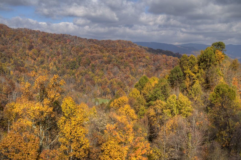 Warm fall colors on a cloudy day at the Metcalf Overlook on Interstate 26 near the Tennessee/North Carolina state border in Flag Pond, TN on Sunday, November 3, 2013. Copyright 2013 Jason Barnette