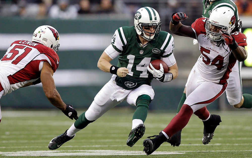 . New York Jets quarterback Greg McElroy (14) runs with the ball as Arizona Cardinals inside linebacker Paris Lenon (51) and outside linebacker Quentin Groves (54) defend during the second half of an NFL football game on Sunday, Dec. 2, 2012, in East Rutherford, N.J. The Jets won 7-6. (AP Photo/Kathy Willens)