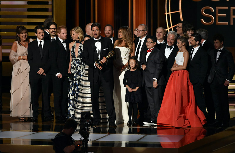 . Show creator Steven Levitan (C) with cast and crew accept Outstanding Comedy Series for \'Modern Family\' onstage at the 66th Annual Primetime Emmy Awards held at Nokia Theatre L.A. Live on August 25, 2014 in Los Angeles, California.  (Photo by Kevin Winter/Getty Images)