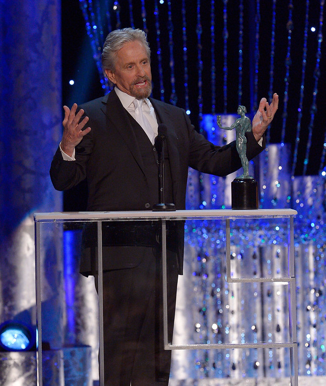 . Michael Douglas accepts Outstanding Performance by a Male Actor in a Television Movie or Miniseries for his performance in �Behind the Candelabra� during the show of the 20th Annual Screen Actors Guild Awards  at the Shrine Auditorium in Los Angeles, California on Saturday January 18, 2014 (Photo by Andy Holzman / Los Angeles Daily News)