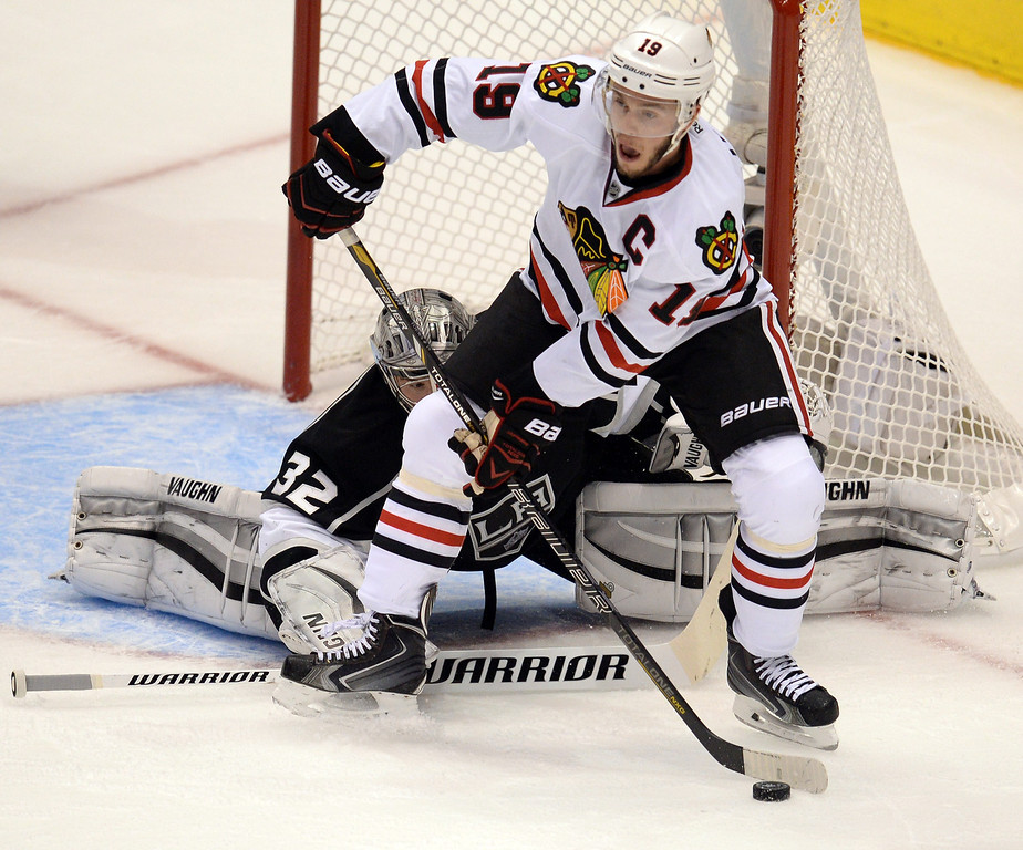 . Blackhawks� Jonathan Toews #19 looks to pass as Kings� goalie Jonathan Quick #32 keeps an eye on the puck during Game 3 of the Western Conference finals at the Staples Center on Saturday, May 24, 2014. (Photo by Hans Gutknecht/Los Angeles Daily News)
