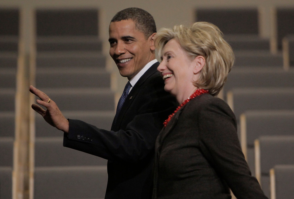 . U.S. President Barack Obama and US Secretary of State Hillary Clinton, right, react as they pass through the main press conference room in between meetings at the U.N. Climate Conference in Copenhagen Friday Dec. 18, 2009.  (AP Photo/Peter Dejong)