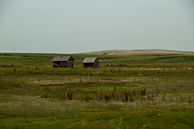 "Some small buildings, and the landscape is starting to get some ""roll"" to it."