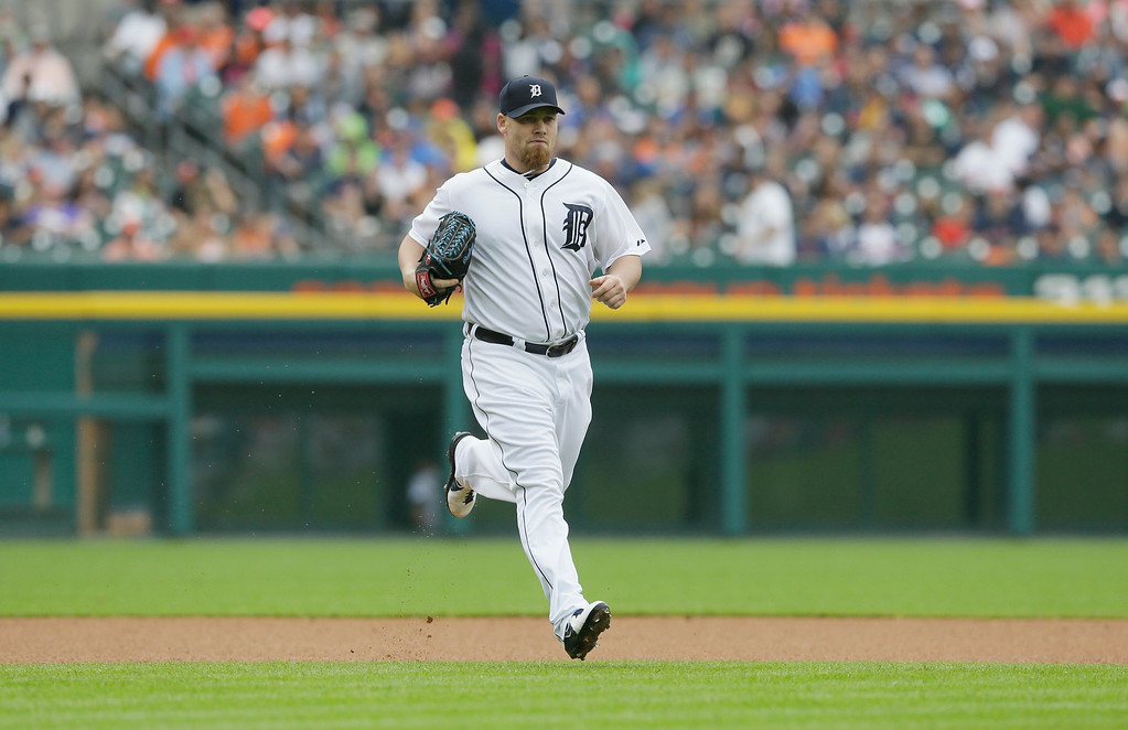 . Detroit Tigers relief pitcher Phil Coke runs to the mound during the seventh inning in the first baseball game of a doubleheader against the Cleveland Indians, Saturday, July 19, 2014 in Detroit. (AP Photo/Carlos Osorio)