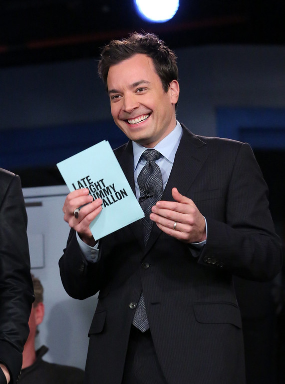 ". This Feb. 18, 2013 photo released by NBC shows Jimmy Fallon, host of ""Late Night with Jimmy Fallon,\"" on the set in New York. As Jay Leno lobs potshots at ratings-challenged NBC in his \""Tonight Show\"" monologues, speculation is swirling the network is taking steps to replace the host with Jimmy Fallon next year and move the show from Burbank to New York.  NBC confirmed Wednesday, March 20, it\'s creating a new studio for Fallon in New York, where he hosts \""Late Night.\"" But the network did not comment on a report that the digs at its Rockefeller Plaza headquarters may become home to a transplanted, Fallon-hosted \""Tonight Show.\""  (AP Photo/NBC, Lloyd Bishop)"