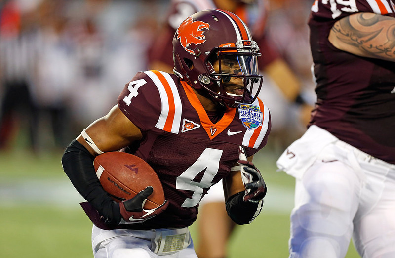 . Running back J.C. Coleman #4 of the Virginia Tech Hokies runs the ball against the Rutgers Scarlet Knights during the Russell Athletic Bowl Game at the Florida Citrus Bowl on December 28, 2012 in Orlando, Florida.  (Photo by J. Meric/Getty Images)