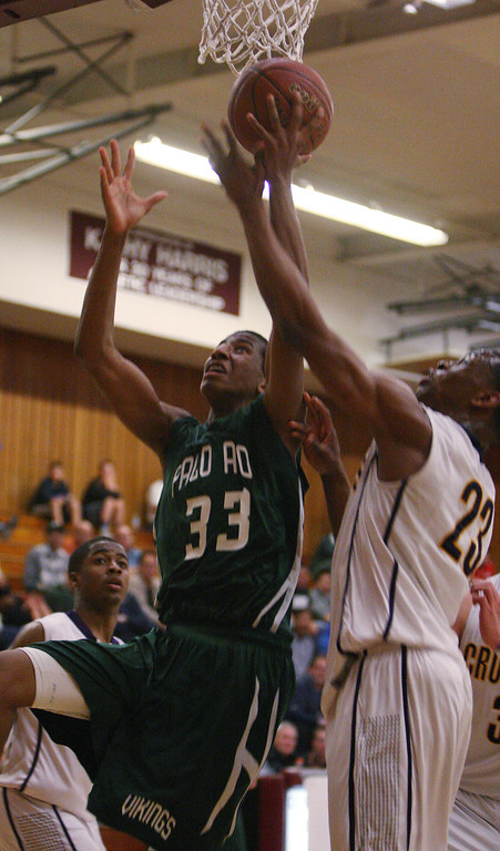 . Paly\'s Aubrey Dawkins fights for a rebound with Riordin\'s Chiefy Ugbaja after missing a shot in the fourth quarter at Piedmont Hills High School in San Jose, Calif. on Friday, Feb. 22, 2013.The Archbishop Riordan Crusaders beat the Palo Alto Vikings, 58-47, in the CCS Open Division boys basketball quarterfinals. (Jim Gensheimer/Staff)
