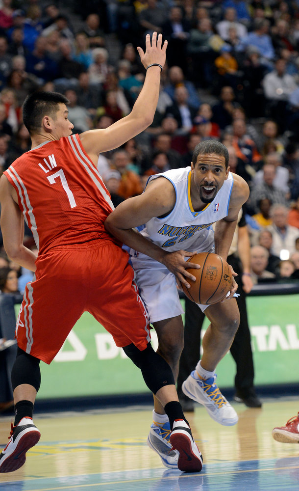 . DENVER, CO. - JANUARY 30: Denver Nuggets point guard Andre Miller (24) works his way around Houston Rockets point guard Jeremy Lin (7) as he drives to the basket during the second quarter January 30, 2013 at Pepsi Center. The Denver Nuggets take on the Houston Rockets in NBA action. (Photo By John Leyba/The Denver Post)