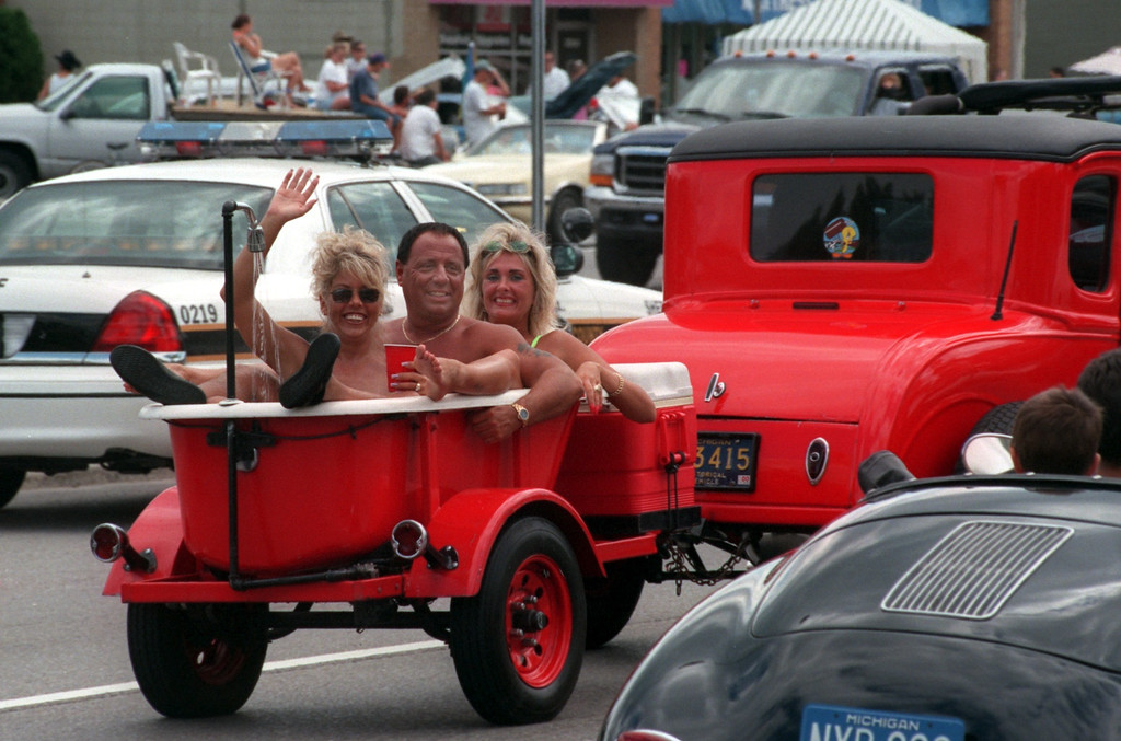 . A threesome in a tub make their way down Woodward Ave. during the Fifth Annual Woodward Dream Cruise.