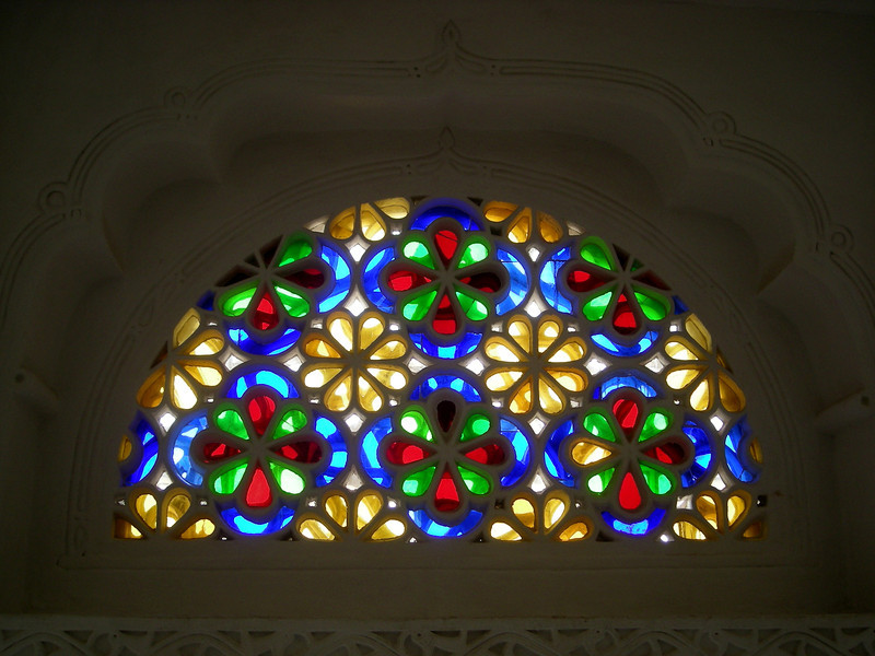at the Rock Palace.  one of the many stained glass half moon windows found in the local architecture.
