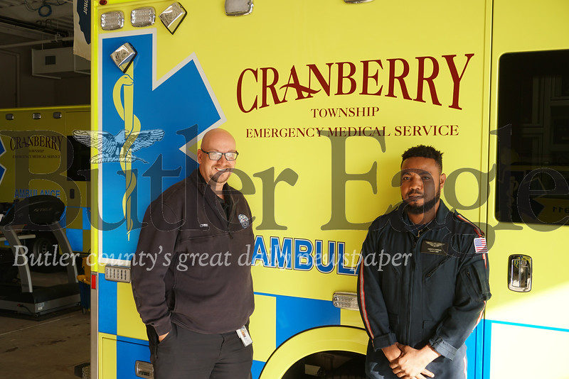 Photo by J.W. Johnson Jr. Cranberry Township EMS Chief and Executive Director Ted Fessides, left, and Oberto Charles pose for a photo Tuesday.