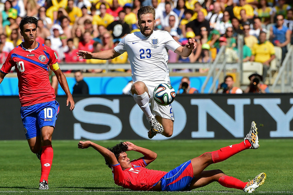 . England\'s defender Luke Shaw (Top) in action during a Group D match between Costa Rica and England at the Mineirao Stadium in Belo Horizonte during the 2014 FIFA World Cup on June 24, 2014.   RONALDO SCHEMIDT/AFP/Getty Images