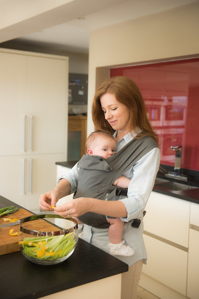 Izmi_Baby_Carrier_Mid_Grey_Lifestyle_Front_Carry_In_Kitchen.jpg