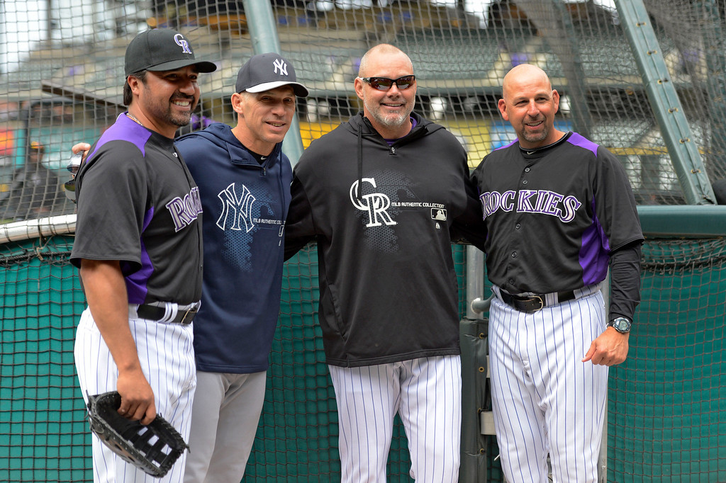 . DENVER, CO. - MAY 07: Colorado Rockies Vinny Castilla, New York Yankees manager Joe Girardi, Dante Bichette and Walt Weis all pose for a photo during batting practice May 7, 2013 at Coors Field. (Photo By John Leyba/The Denver Post)