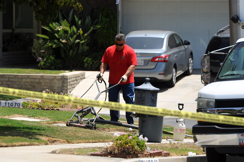 . Cleanup at the scene on the 19200 block of Kenya Street in Northridge, Friday, June 15, 2013, where a woman was murdered and the suspect surrendered to SWAT officers following a nighttime standoff. (Michael Owen Baker/Staff Photographer)