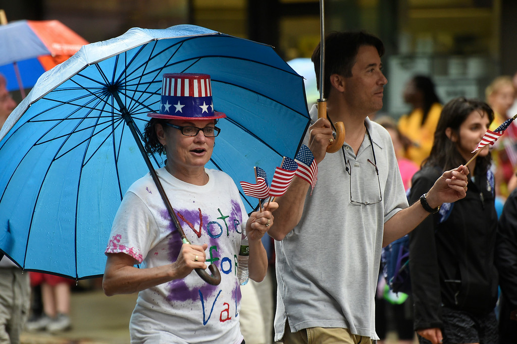 . Kayla Rice/Reformer Valarie Stuart walks in the Brattleboro Fourth of July parade on Friday.