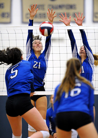 10/30/2018 Mike Orazzi   Staff Bristol Eastern's Aliana Rivoira (21) and Ryley Plourde (11) with Glastonbury's Olivia Sadak (5) during the CCC volleyball tournament at Eastern Tuesday.