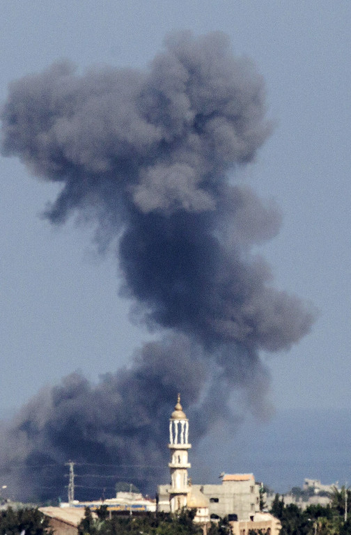 . A picture taken from the Israeli border with the Gaza Strip shows smoke billowing from the coastal Palestinian enclave following an Israeli air strike on July 16, 2014. New Israeli air and tank strikes in Gaza killed several people, medics said, bringing the death toll from Israel\'s operation in the besieged Palestinian territory to 205. AFP PHOTO / JACK GUEZ/AFP/Getty Images