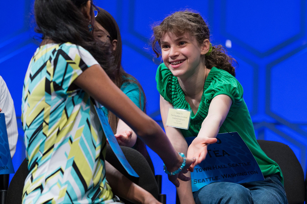 ". Tea Freedman-Susskind of Redmond, Wash., right, is congratulated after spelling ""camembert\"" correctly during the semifinal round of the National Spelling Bee, Thursday, May 29, 2014, in Oxon Hill, Md. (AP Photo/ Evan Vucci)"