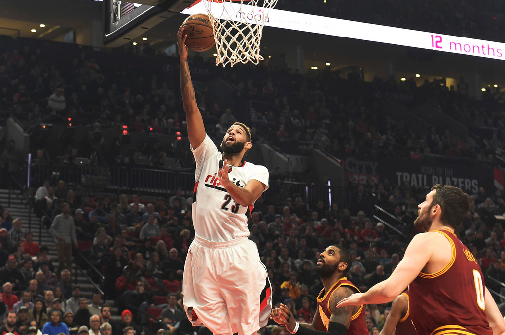 . Portland Trail Blazers guard Allen Crabbe drives to the basket on Cleveland Cavaliers guard Kyrie Irving and forward Kevin Love during the second half of an NBA basketball game in Portland, Ore., Wednesday, Jan. 11, 2017. The Blazers won 102-86. (AP Photo/Steve Dykes)