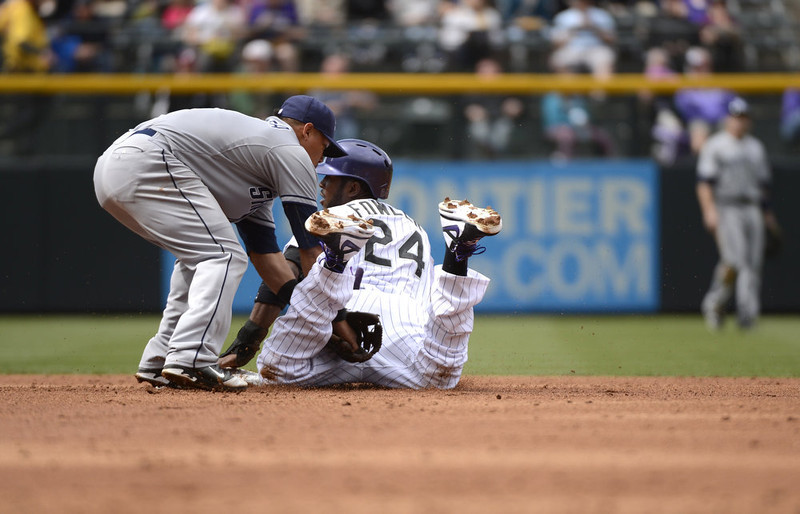 . Colorado Rockies Dexter Fowler (24) looks over to the umpire after stealing second base in the third inning as San Diego Padres Everth Cabrera (2) tags him late April 7, 2013 at Coors Field. (Photo By John Leyba/The Denver Post)