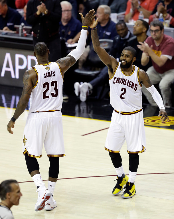 . Cleveland Cavaliers\' LeBron James (23) and Kyrie Irving (2) celebrate a play against the Golden State Warriors during the second half of Game 3 of basketball\'s NBA Finals in Cleveland, Wednesday, June 7, 2017. (AP Photo/Tony Dejak)