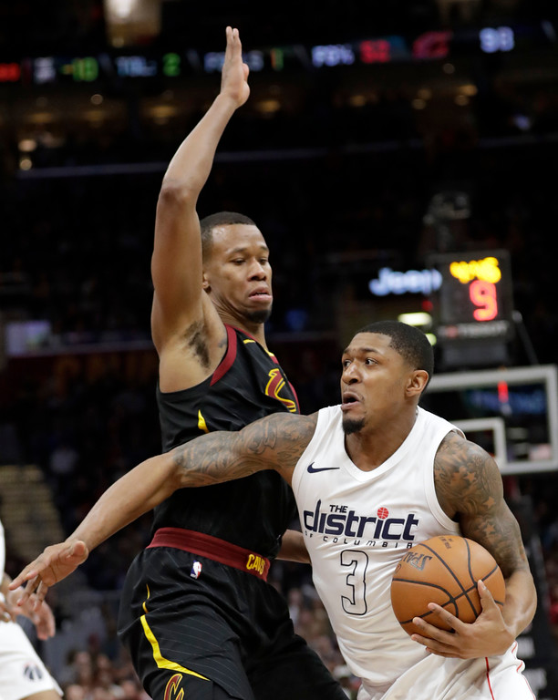 . Washington Wizards\' Bradley Beal (3) drives past Cleveland Cavaliers\' Rodney Hood, left, in the second half of an NBA basketball game, Thursday, April 5, 2018, in Cleveland. (AP Photo/Tony Dejak)