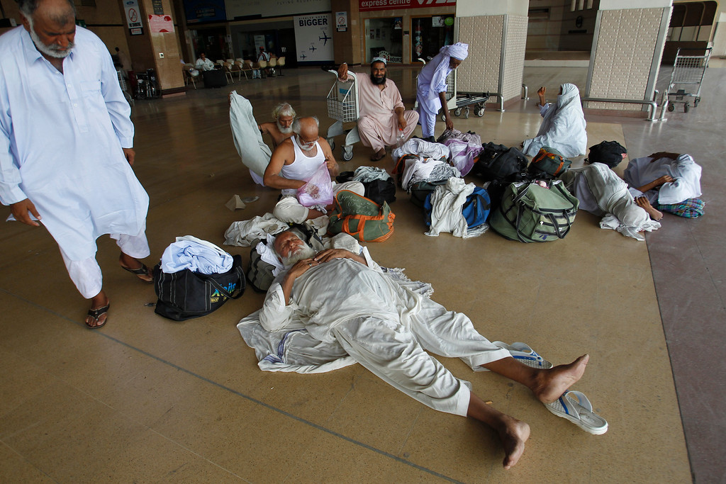 . Passengers stranded at the Jinnah International Airport rest in Karachi, Pakistan, Monday, June 9, 2014. The Pakistani Taliban on Monday claimed responsibility for a brazen five-hour assault on the country\'s busiest airport that saw gunmen disguised as police guards storm the international terminal in Karachi, set off explosions and killing over a dozen of people. (AP Photo/Fareed Khan)