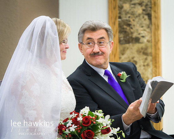 Bride and groom with Bible during wedding ceremony