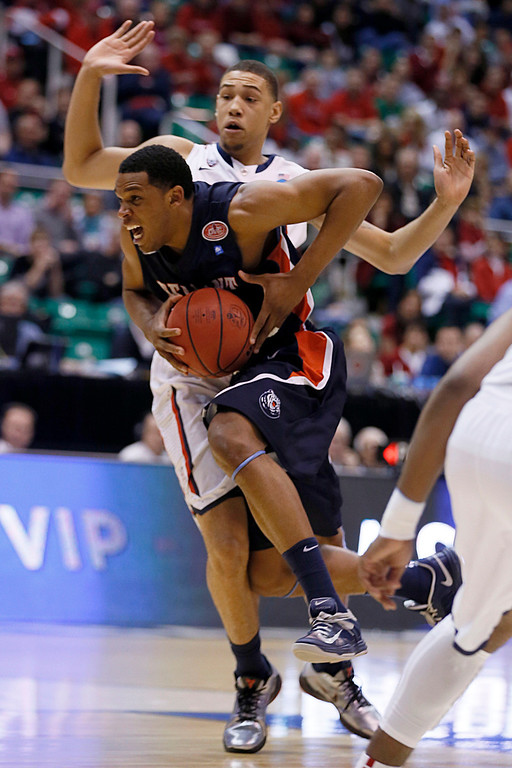 . Belmont\'s Blake Jenkins, front, drives past Arizona\'s Brandon Ashley in the second half during a second-round game in the NCAA college basketball tournament in Salt Lake City, Thursday, March 21, 2013. Arizona won 81-64. (AP Photo/George Frey)