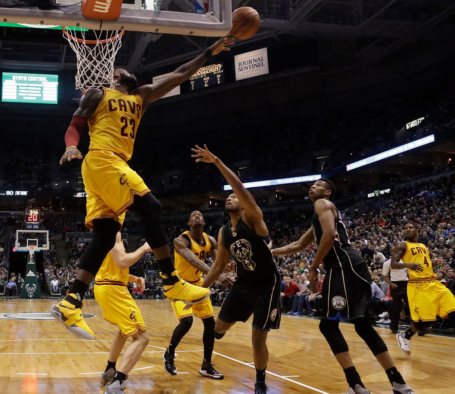 . Cleveland Cavaliers\' LeBron James blocks a shot during overtime of an NBA basketball game against the Milwaukee Bucks Tuesday, Dec. 20, 2016, in Milwaukee. The Cavaliers won 114-108. (AP Photo/Morry Gash)