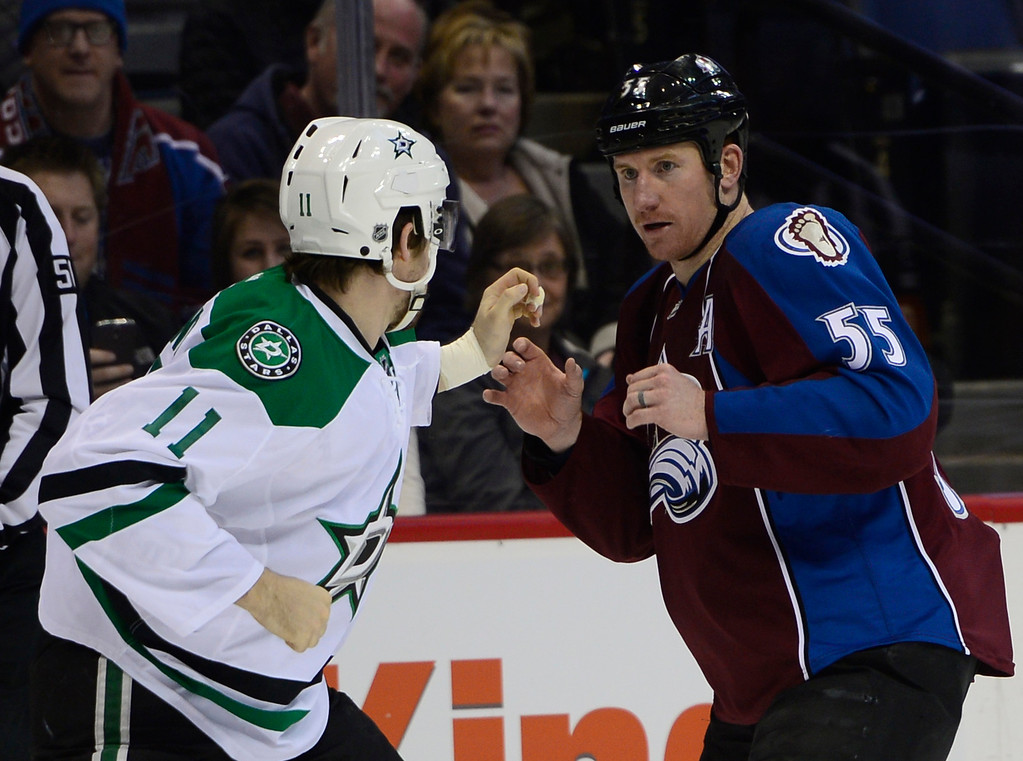 . Colorado Avalanche left wing Cody McLeod (55) watches for the first punch from Dallas Stars left wing Curtis McKenzie (11) during the first period Saturday, February 14, 2015 at the Pepsi Center in Denver, Colorado. (Photo By Brent Lewis/The Denver Post)
