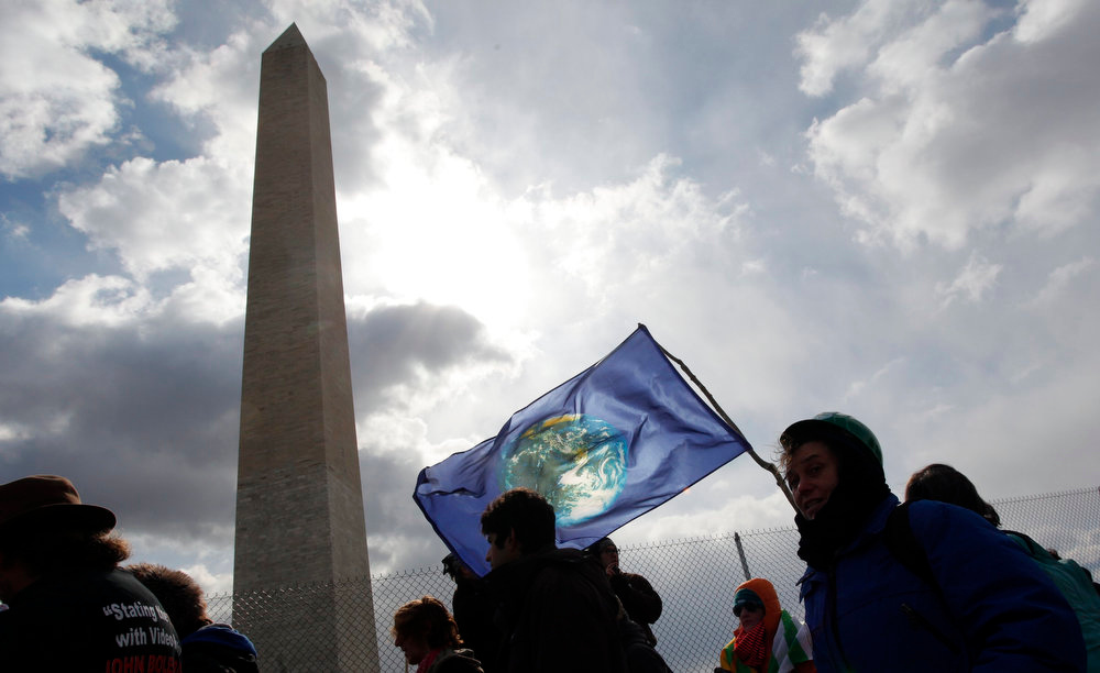 . Demonstrators protest against the Keystone XL pipeline in front of the Washington Monument in Washington, February 17, 2013. The TransCanada Corp pipeline would link the oil sands of northern Alberta, the world\'s third largest crude resource, to refineries and ports in Texas. Environmentalists say approval of the pipeline will encourage more development in the oil sands, where extraction is carbon intensive, leading to greater greenhouse gas emissions. REUTERS/Richard Clement