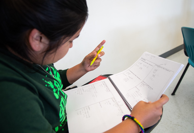 Gabriella Trevino-Garcia focuses in on calculating term f on a TSI practice problem in Campus East for TSI Prep conducted by Project Grad this week