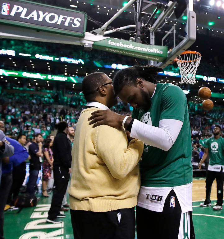 . Boston Celtics forward Jae Crowder, right, prays with team chapin Rev. Robert Gray before the first half of Game 7 of an NBA basketball second-round playoff series Boston, Monday, May 15, 2017. (AP Photo/Charles Krupa)