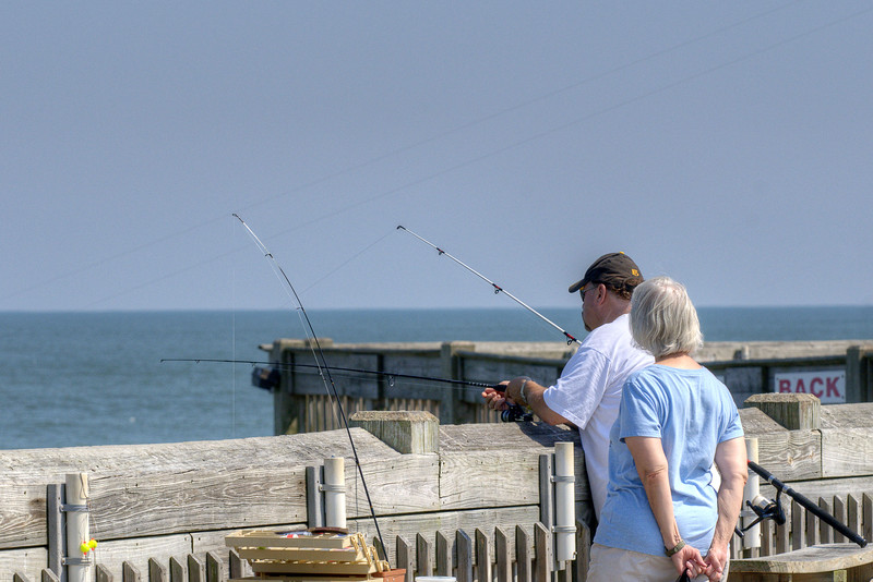 A couple spend a day fishing on the Edwin S. Taylor Fishing Pier in Folly Beach, SC on Sunday, September 8, 2013. Copyright 2013 Jason Barnette